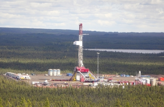 An aerial view of a Nexen well in northeast B.C. A water license for one of its fracking operations near Fort Nelson has been cancelled. Photograph by: Dave Olecko/Vancouver Sun.
